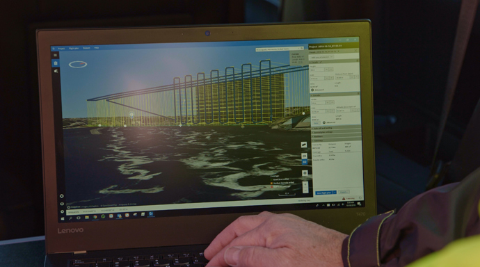 Engineers use Intel Mission Control software to design the flight plan for the visual bridge inspections. In partnership with the Kentucky Transportation Cabinet and Michael Baker International, Intel used its drone technology to help inspect and analyze the Daniel Carter Beard Bridge, an eight-lane interstate across the Ohio River. (Credit: Intel Corporation)