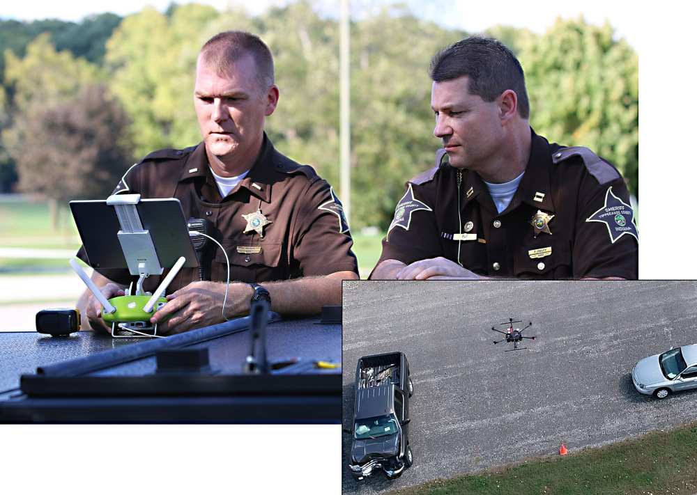 Capt. Rob. Hainje and Capt. Terry Ruley of the Tippecanoe County Sheriff's Office test drone technology for use at vehicular crash sites. The office used the technology to map vehicular crash scenes 20 times in 2018. (John Bullock and Erin Easterling/Purdue University)