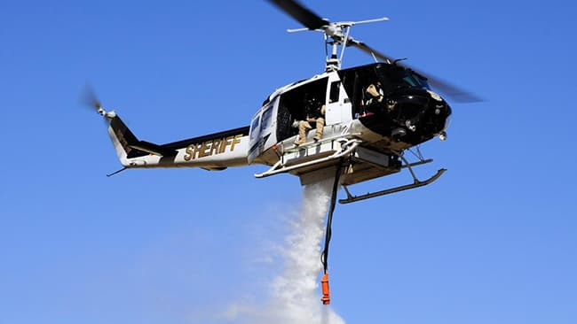 Washoe County UH-H1 helicopter during water drop