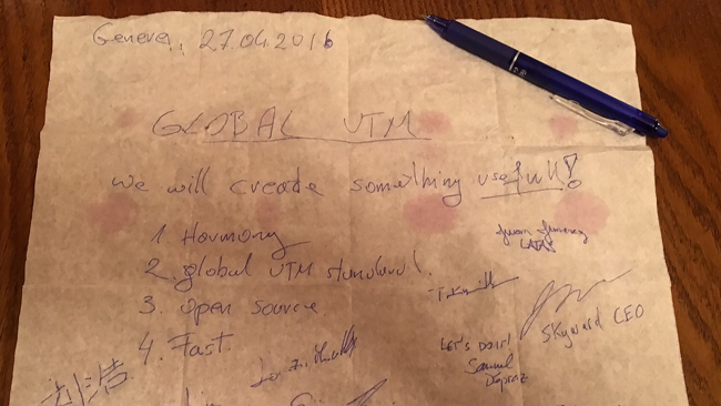 Ephemera - GUTMA's charter written on a cocktail napkin and signed by all