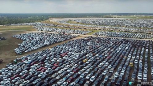 Drone video shows thousands of flooded cars being stored at Texas World Speedway