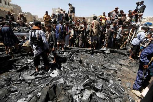 People gather around the engine of a drone aircraft which the Houthi rebels said they have downed in Sanaa, Yemen October 1, 2017. REUTERS:Khaled Abdullah 5