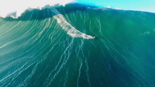 Drone video of surfer riding giant wave in Nazaré, Portugal 0003