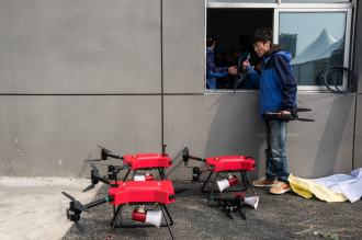 Drones used to sonically repel birds during flight activities at Hannan General Aviation Airport in Wuhan. Credit Lam Yik Fei for The New York Times