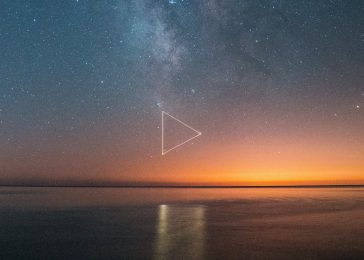 Photographer uses a drone to create glowing symbols over water 1