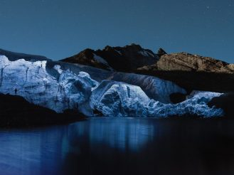 Glaciers dramatically lit up at night by a drone 1
