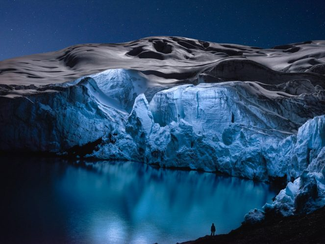 Glaciers dramatically lit up at night by a drone 2