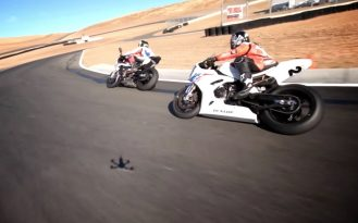 FPV drones race BMW S1000RR motorcycles on Thunderhill Raceway in this amazing video. Sometimes you wonder if these FPV drone videos can get much better.