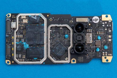 DJI-Mavic-Mini-drone-teardown-guide-repair-mainboard-top-heatspreaders-removed-processors-in-view-cleared-1200x801