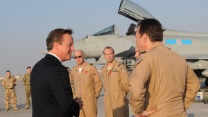 David Cameron with RAF pilots at Al Minhad Air Base in UAE (credit Stefan Rousseau/PA)