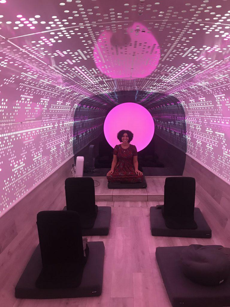 Wide view inside Be Time meditation studio - pink lights