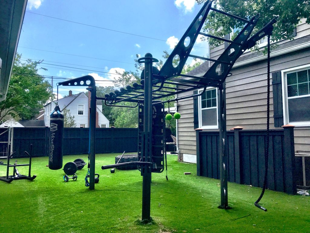 An extensive garden gym rig with tire and hammer, prowler sled, trap bar and more!