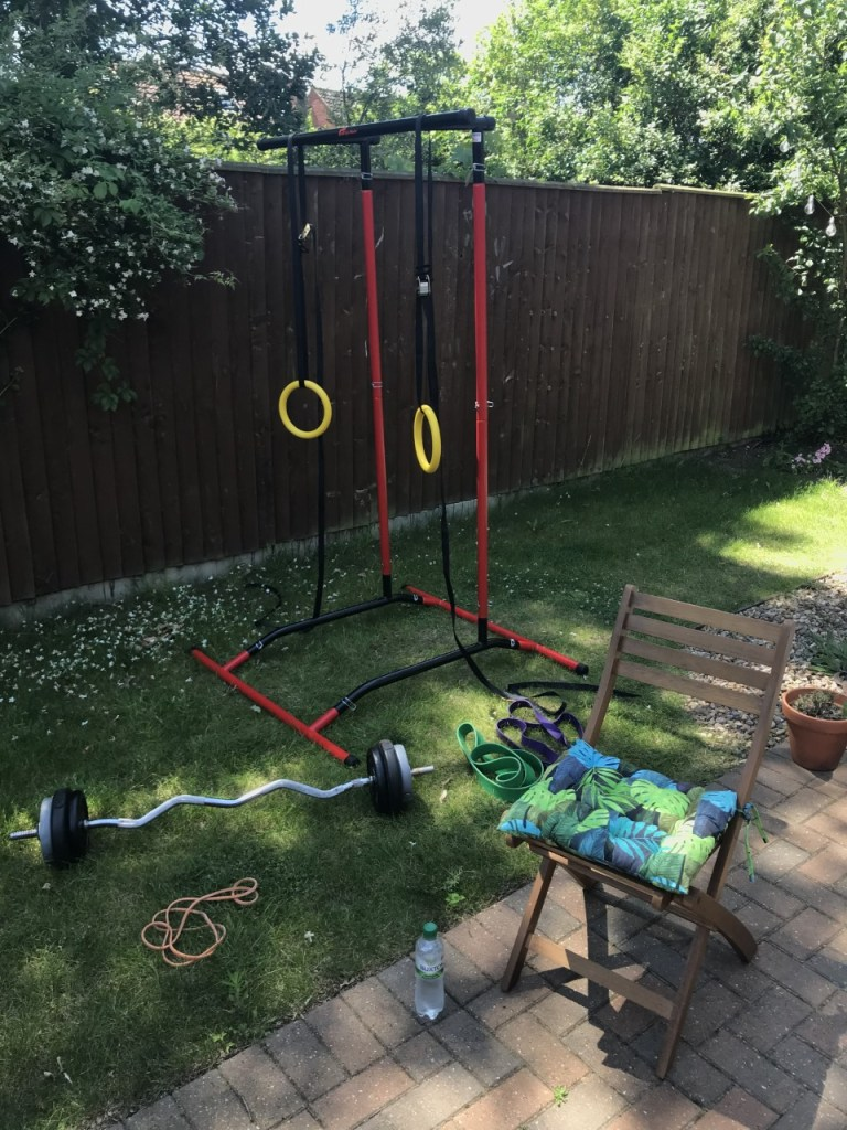A ring pull-up station and an EZ curl bar.