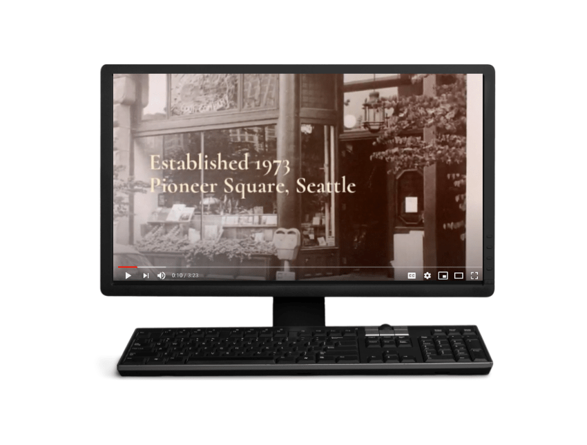 """Video still showing old Elliott Bay Book Company storefront with the text """"Established 1973, Pioneer Square, Seattle"""""""