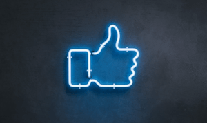 Neon light shaped like social like thumbs-up