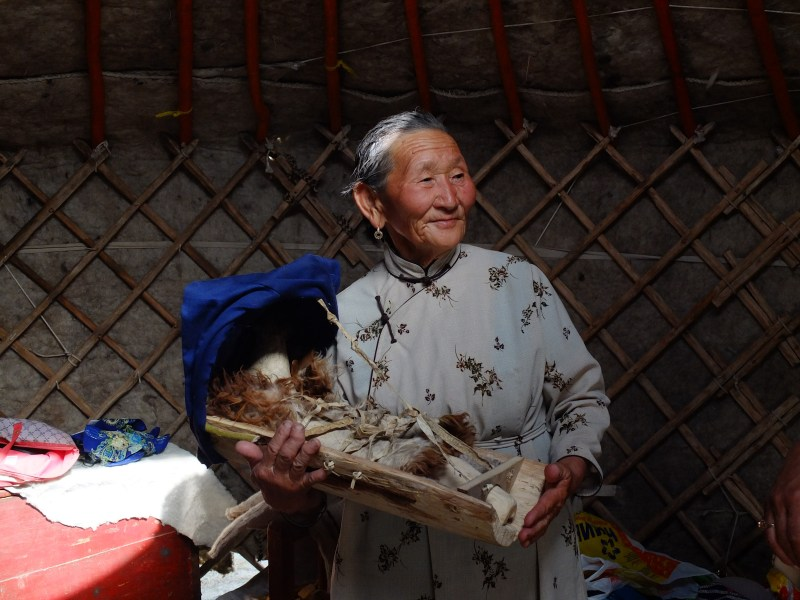 A woman shows us how babies were traditionally carried. This was a yurt set up traditionally for demonstration.