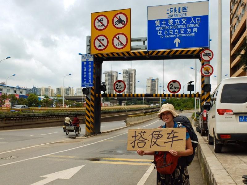 搭便车 or da bien che means hitchhiking in Chinese. This picture was taken south in Yunnan, but it proved irreplaceable all the way to Mongolian border post!