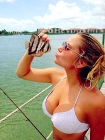 Fishing girl cleavage