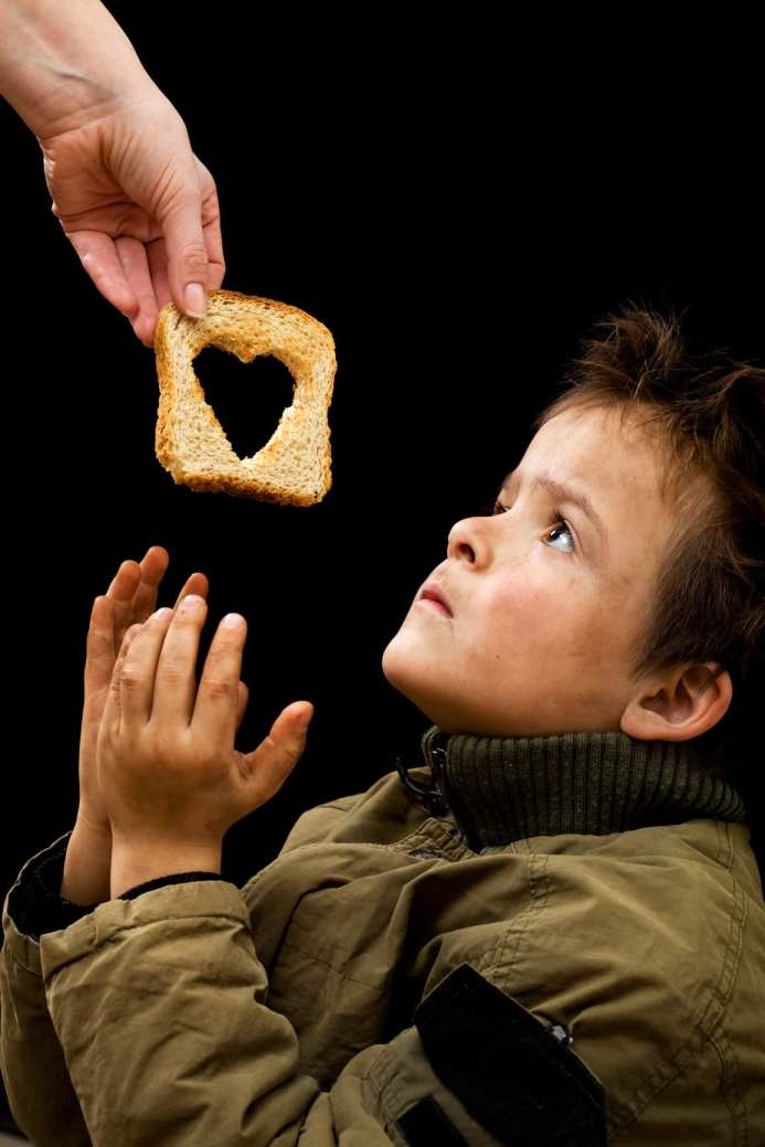 stockfresh 1665628 feeding the poor sizeM mini - Shocking Effects of Poverty on Education