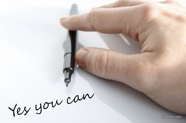 Pen in the hand isolated over white background Yes you can concept