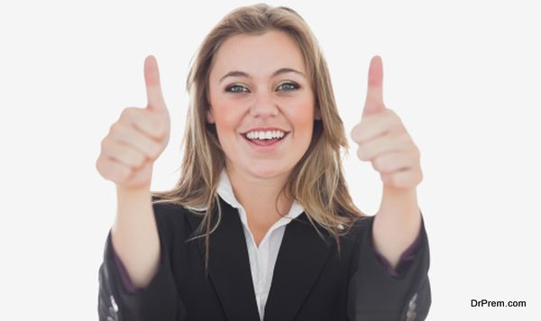 Happy business woman gesturing thumbs up