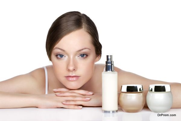 young woman and skincare products