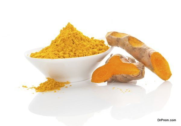 Turmeric, ayurvedic tradtional medicine. Dry ground turmeric and fresh root isolated on white background.