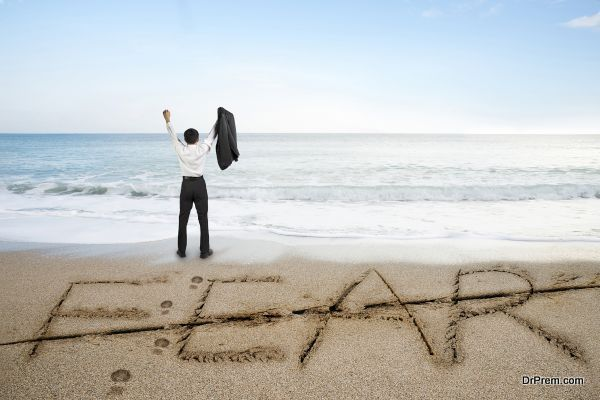 Businessman cheering with fear word deleted line written on sand beach background
