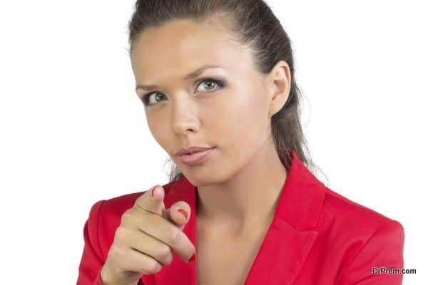 Businesswoman pointing forefinger at camera