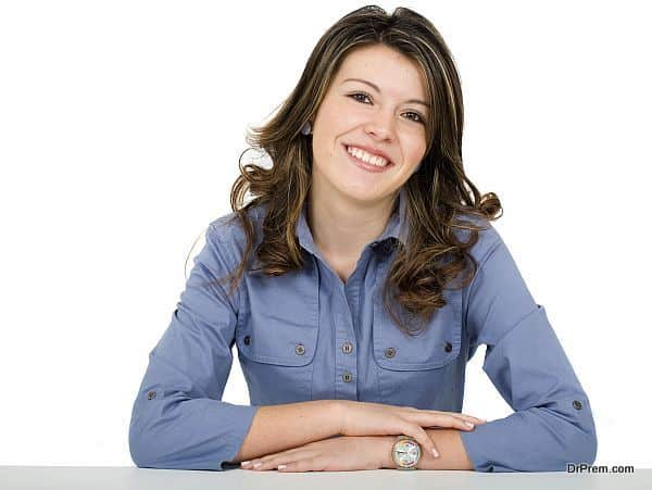 beautiful young business woman portrait - smiling over a white background