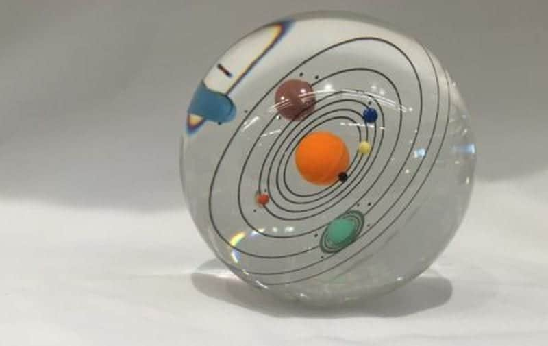 Paperweight with a solar system