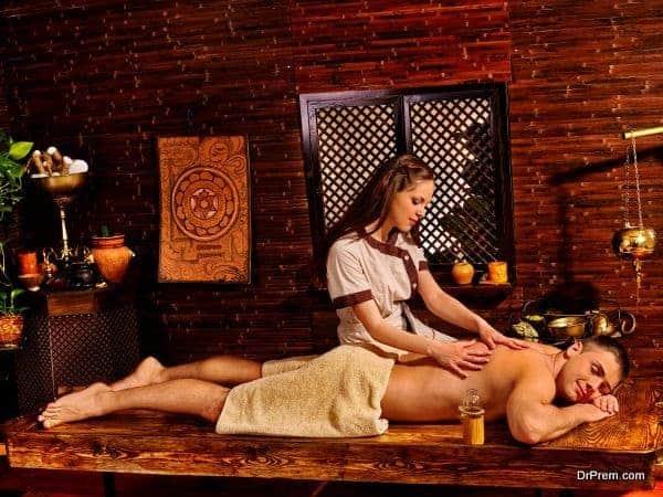 Man having Ayurvedic spa treatment