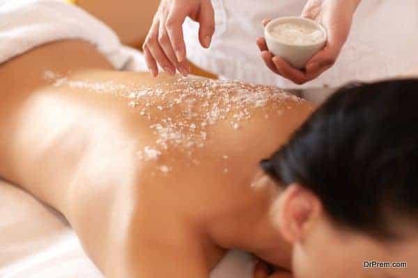 Spa Woman. Brunette Getting a Salt Scrub Beauty Treatment