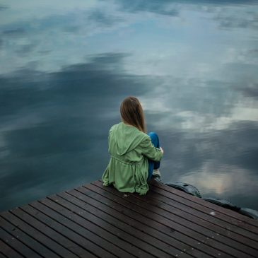 Girl on a JEtty for post on anxiety