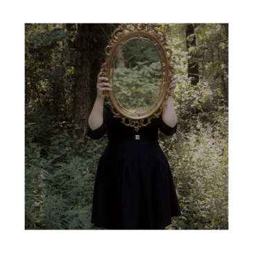 image of women with a mirror over her face to represent cognitive distortion