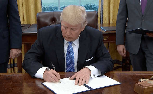 https://i1.wp.com/drrichswier.com/wp-content/uploads/president-trump-signing-executive-order-e1485193456428.png