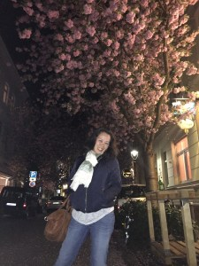 Anna with the cherry blossoms out the front of Billa-Bonn.