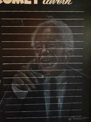 Someone drew Bernie Sanders on a pub chalkboard