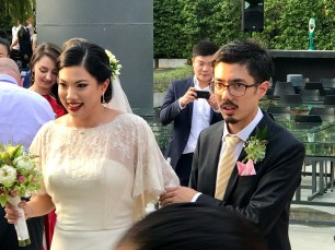 Noelle being walked down the aisle by her brother