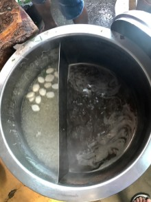 Fishballs boiling on the left, broth on the right