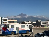 A nearby mountain behind a random bus (not ours)