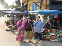 Anna, Momo, and Takuo in a market