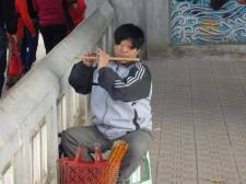 A guy born without eyes playing a flute