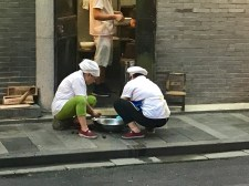 Chefs killing something on the footpath