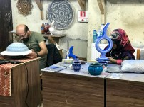 People working on the ceramics