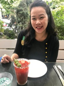 Anna having a bloody mary with brunch