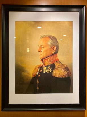 A portrait of Rear Admiral Bill Murray near the elevators