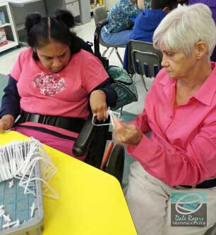 Luz works with volunteer Janell at DRTC.