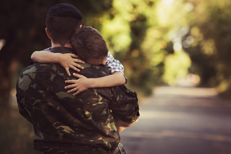 Woman and soldier in a military uniform say goodbye