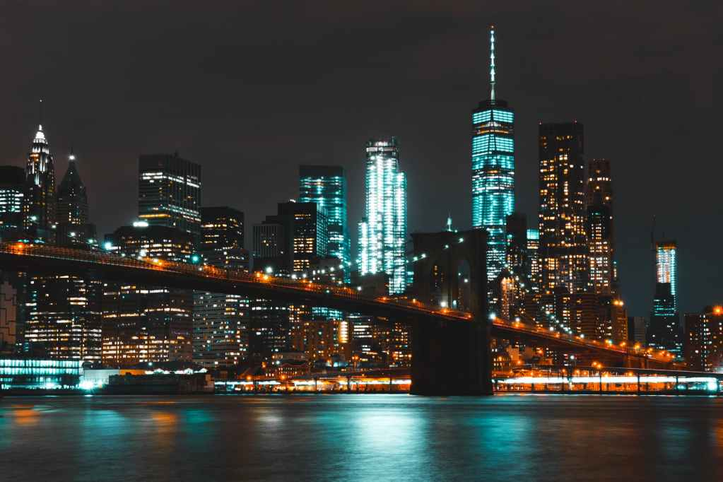 lighted brooklyn bridge during nighttime